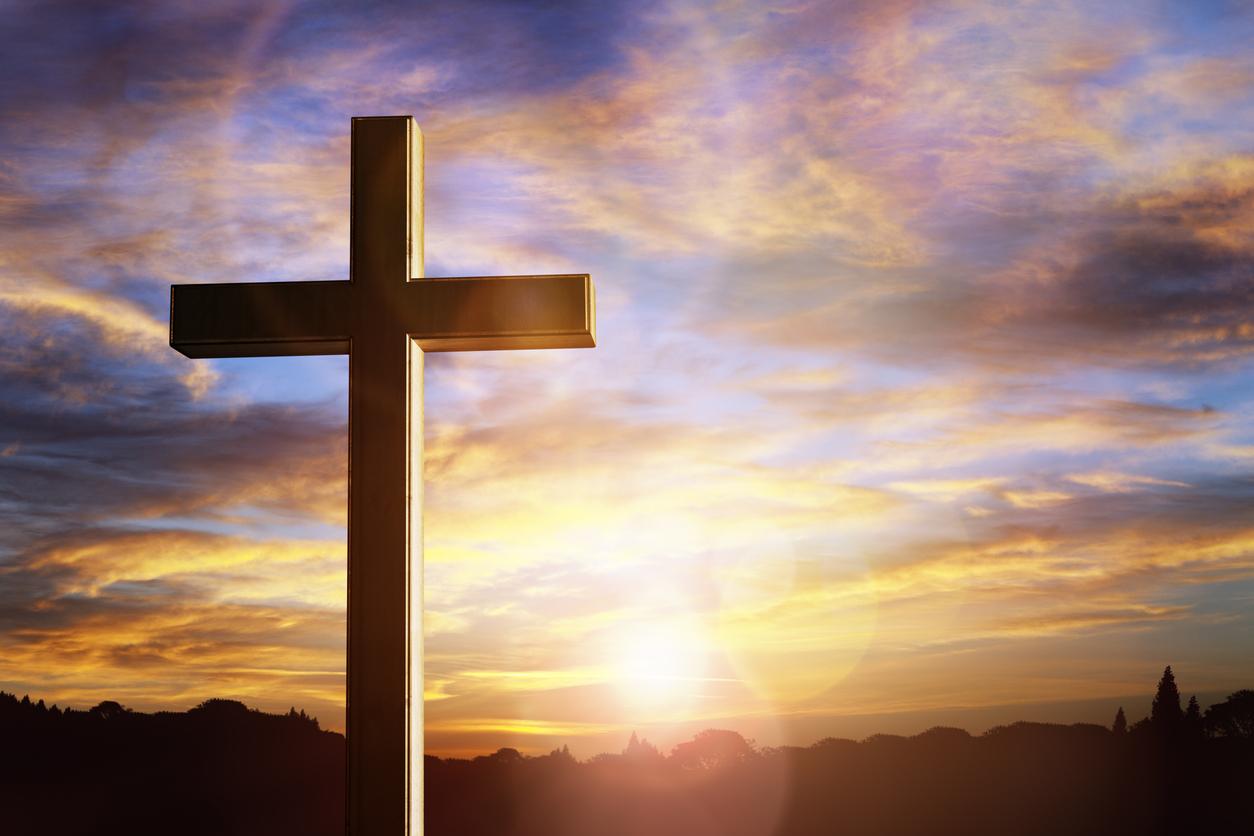 Crucifix cross at sunset background, crucifixion of Jesus Christ
